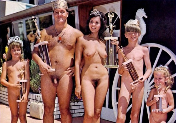 nudist family standing and each one with a trophy